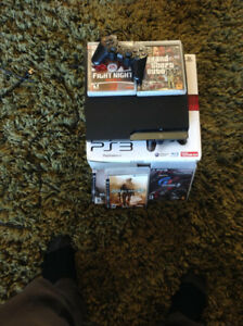 PS3 120GB with addicting COD, GTA, UFC, box, controller, cables