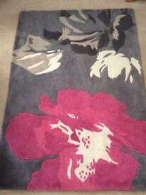 Beautiful hand made in China rug.