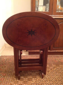 4 foldable sid tablas, a hutch buffet and a framed painting