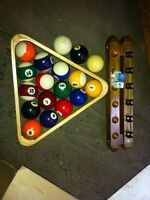Set of pool balls and cue rack