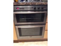 Double oven, electric hob, extractor fan and splashback