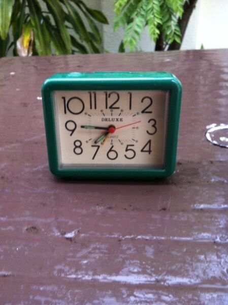 Deluxe alarm clock.  Dimension 11 x 9 x 4cm.  In good working condition.