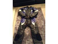 Frank Thomas two piece titanium motorbike leathers
