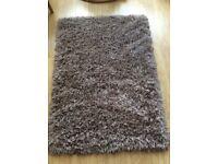 Shaggy mink coloured hearth rug