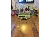Brand new Xbox 360 only used 3 times with 8 games with wires