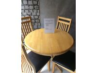 Round extending dining table with 4 chairs