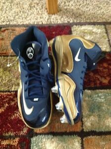 Nike size 11.5 blue and gold football shoes