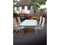 Garden table and 4 Chairs. £80
