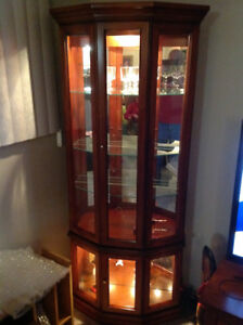 For sale is a solid wood corner curio cabinet with 2 lights