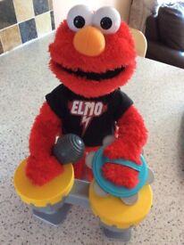 Let's Rock Elmo. Singing dancing musical interactive toy. Sesame Street.