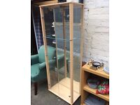 Tall rectangular glass display cabinet