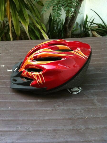 Adult red bike helment. Size Large with adjustable strap for head, Only used once.