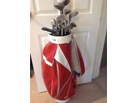 Golf carry bag with two sets of clubs