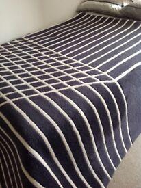 100% wool rug black and cream