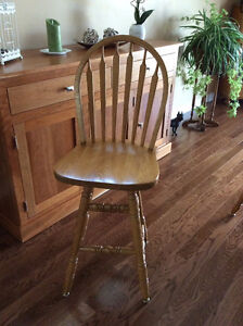 Two solid oak bar chairs