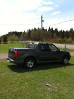 2002 ford explorer sport trac pickup. Priced at only 5,000neg