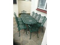 CAST ALUMINIUM GARDEN TABLE AND 10 CHAIRS