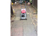 Four wheeled mountfield petrol push mower