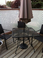 Table, chairs, umbrella and stand