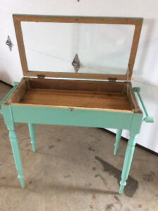 Vintage table with glass top..
