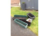 Assorted plastic planters for sale
