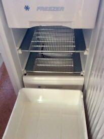 Freezer, white, under counter.