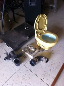 Camper toilet and assembly with tank