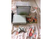 Xbox 360 with 2 games and pad