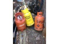 3 empty gas bottles