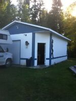2 bedroom mobile with 22X28 heated shop on .86 acres