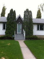 Bright Inner City Home * Heated 3 Car Garage with workshop*