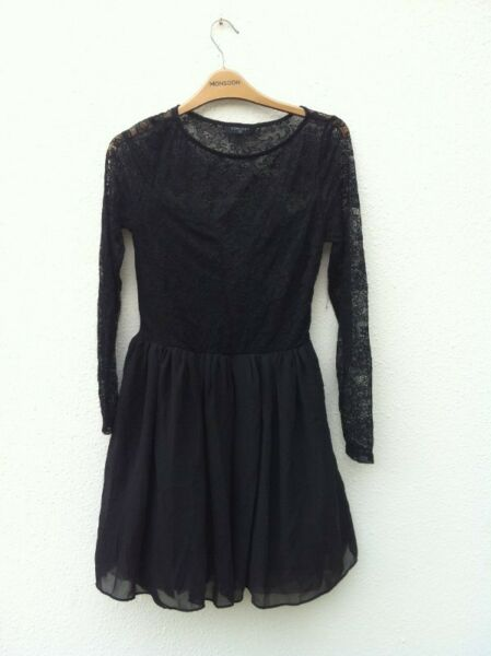Osmose black party dress. Size 2.  Used only a few times and in good condition.