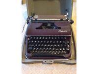 Olympia maroon 1950s typewriter