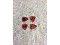 4 fender guitar picks signed by the arctic monkeys 100% genuine