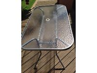 Glass six seater garden table (as new)