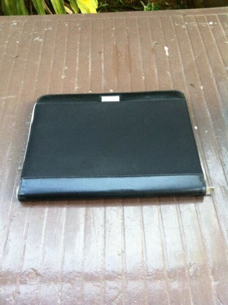Portfolio case with working calculator. In good condition.