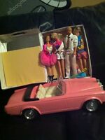 4 Barbie Dolls with pink Convertible car