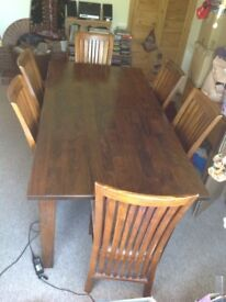 Solid wood extendable dining table and chairs