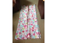 Pair of pretty pink kids tab top curtains from Next