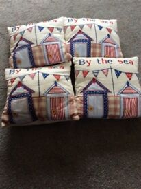 """Four small """"By the sea"""" cushions"""