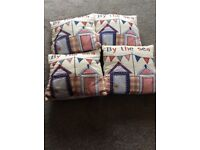 "Four small ""By the sea"" cushions"