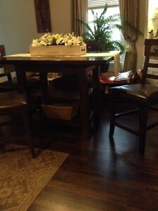pub style dining room table and four chairs