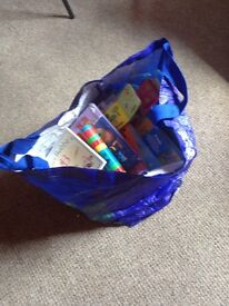Bag of baby toddler books and teddies