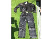 """Leather jacket and jeans biker wear. 34""""w x32"""" jeans46"""" jacket ."""