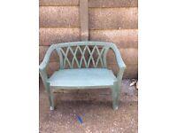 Green plastic garden bench