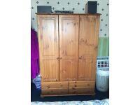 Triple door solid pine wardrobe.