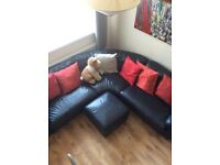 Black leather corner sofa good condition with stool first £50 takes it