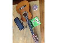 Child's Guitar, case, song book, cd, foot rest and tuning pipe.