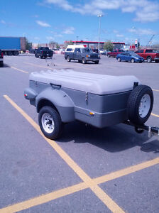 A covered utility 2 wheeled, poly built trailer