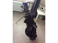 Golf clubs, bag, ball collector, and other accessories
